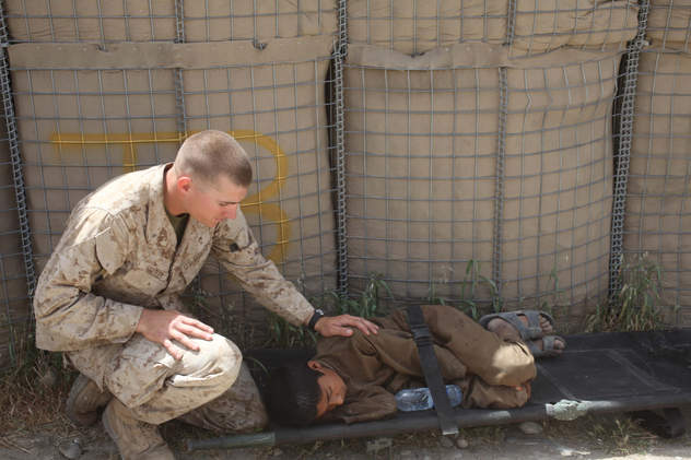 Marine comforts wounded boy