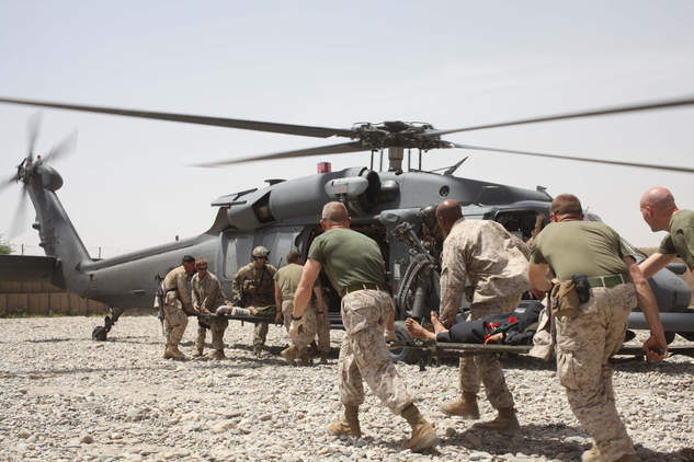 Marines load wounded on helicopter