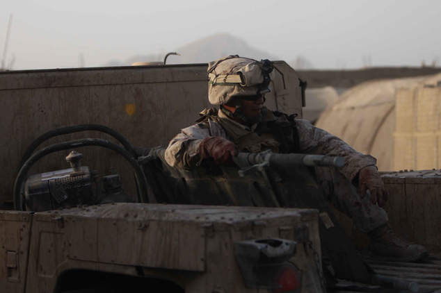 Corpsman waits in back of humvee during shooting on base