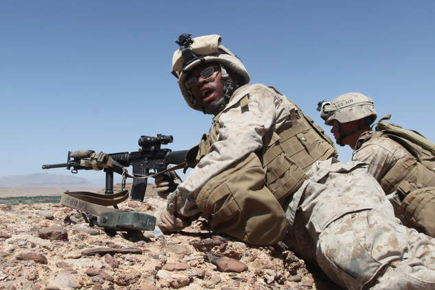 LCpl Ron Holton yells the location of enemy fighters to fellow marines