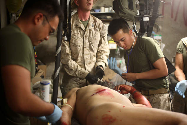 Corpsmen treats wounded man