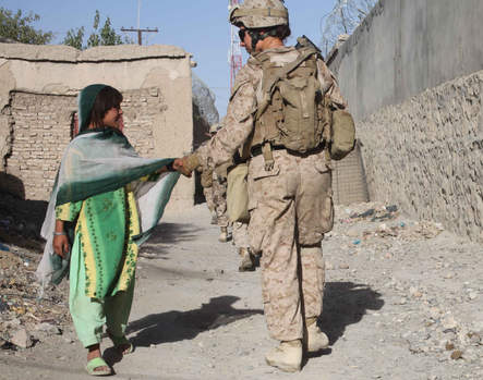 Marine shakes hands girl