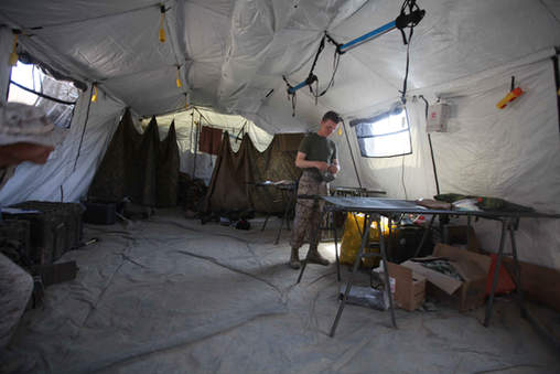 Corpsman sets up a field medical tent