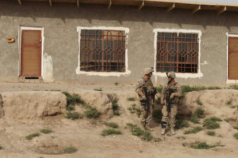 Marines outside of Afghan house