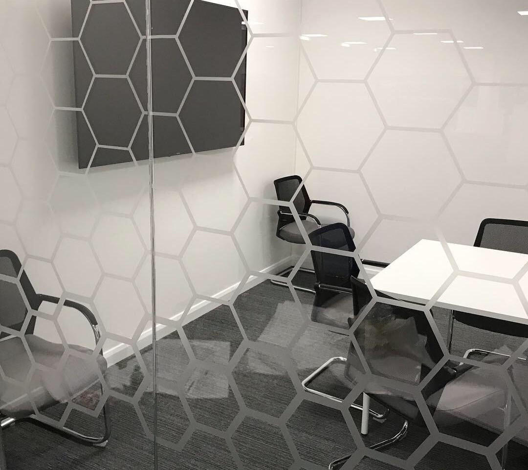 finished meeting room with manifestations to glass partitioning
