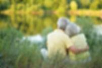 Beautiful senior couple hugging in the p