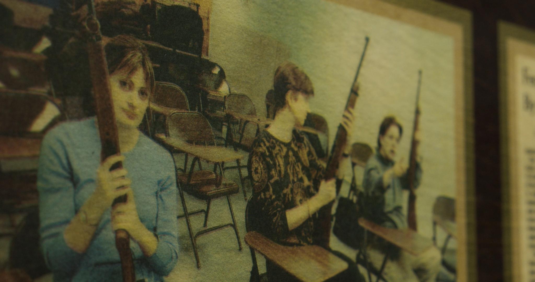 Women with firearms in newspaper.jpg