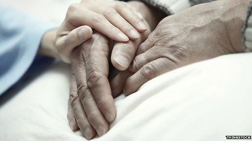 young hand place on elderly hands
