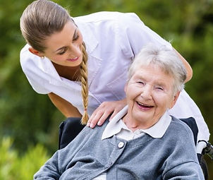 Caregiver and resident smiling