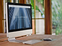 imac-on-wooden-table.png