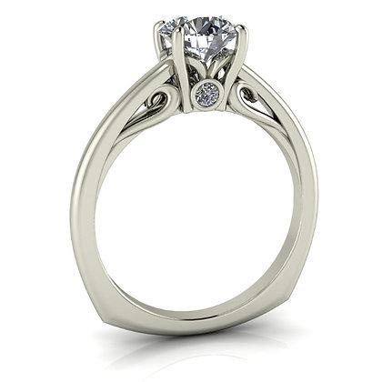 White gold solitiaire with peek-a-boo diamond