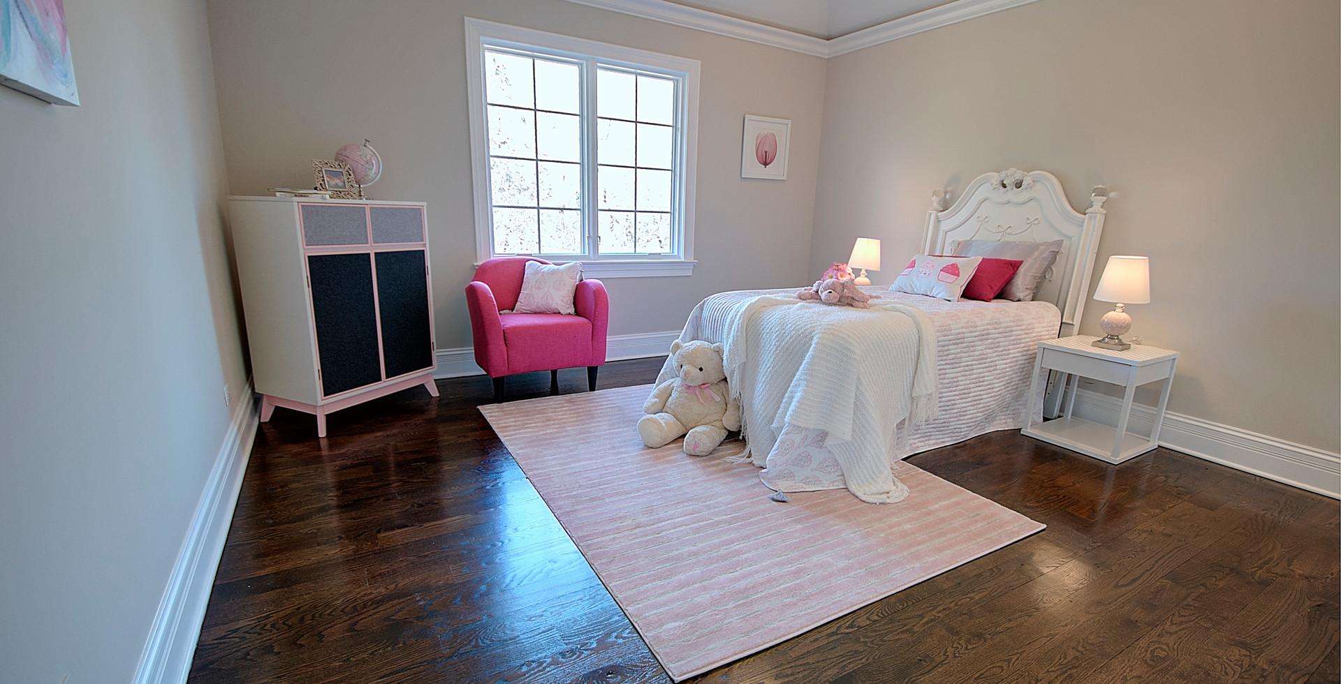 Bedroom in Franklin Park designed by MRM Home Design.jpg