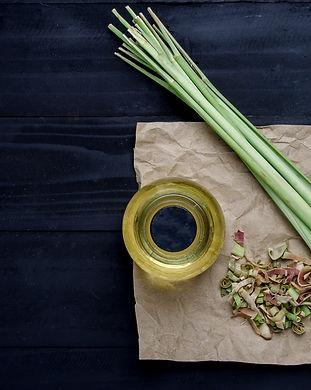 Lemongrass Oil on Black Wooden Table..jp