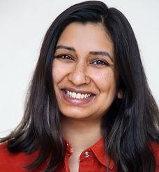 Headshot of Radhika Aggarwal smiling to the camera_edited.jpg