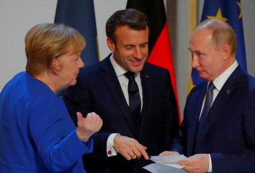 Συνεργασία για τα εμβόλια συζήτησαν Μέρκελ-Μακρόν με Πούτιν