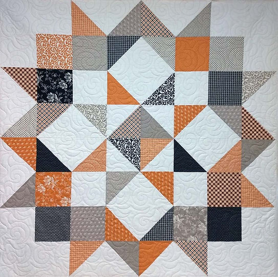 Geometric quilt with swirls longarm quil