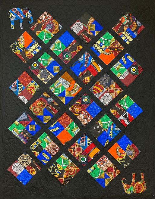 African 4 patch quilt with longarm quilt