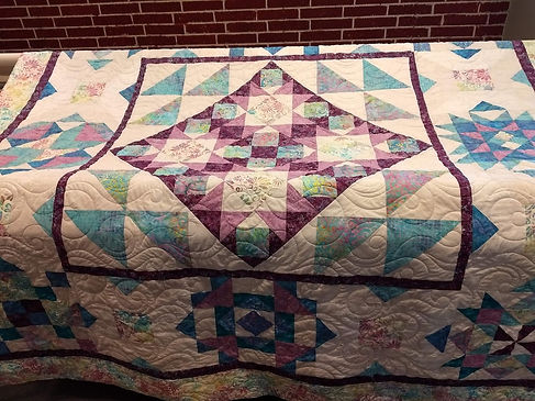 large quilt with Bora Bora longarm quilt