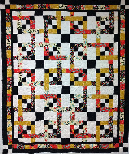 quilt with sewing themed fabric and long