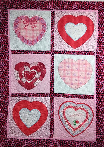 Heart applique quilt longarm quilting by