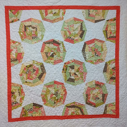 Kaleidoscope quilt with meandering longa