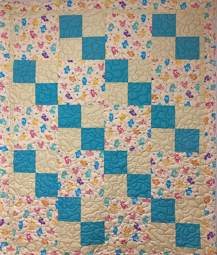 Care Bear quilt longarm quilting by Appl
