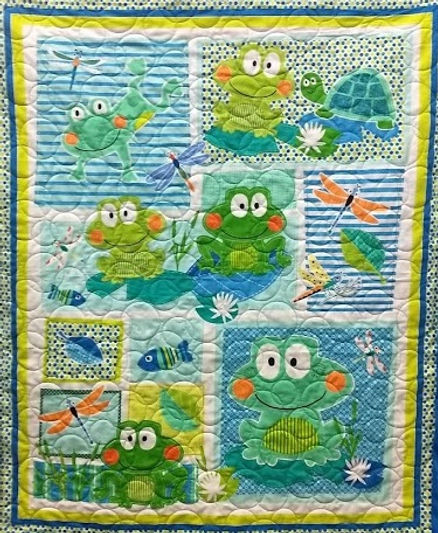Frog panel quilt with bubble longarm qui
