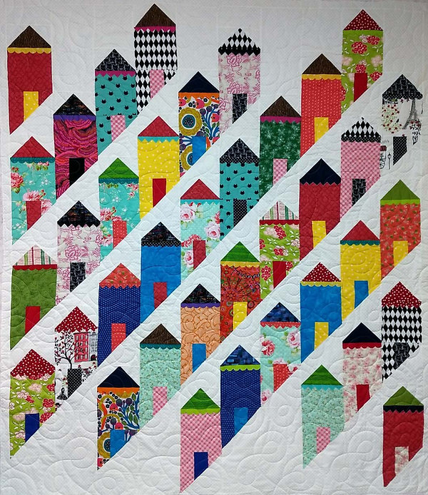 Quilt with pieced tall house and longarm