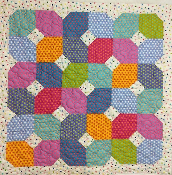 quilt top pieced with dotted fabrics and