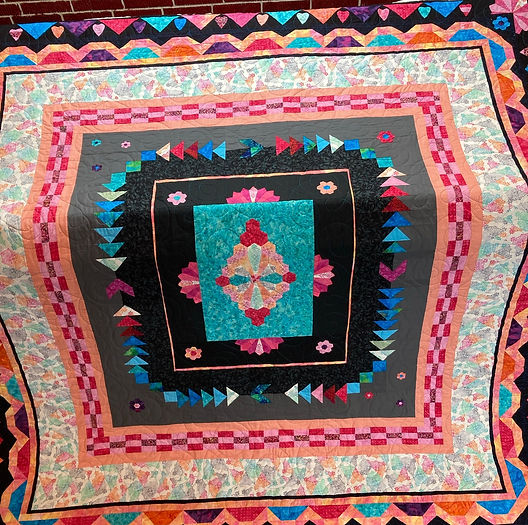 very colorful medallion quilt.JPEG
