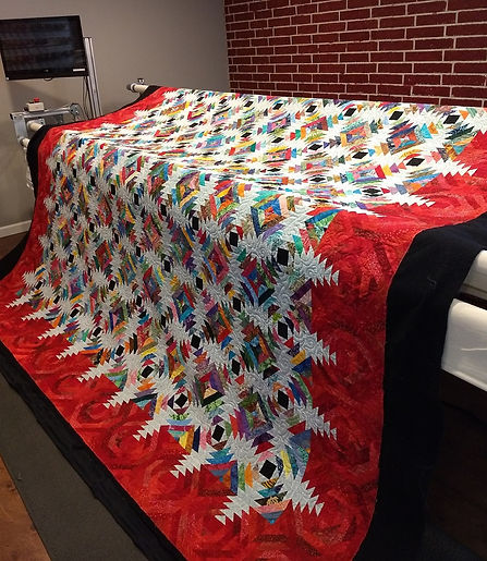Longarm a king size quilt at Apple Baske