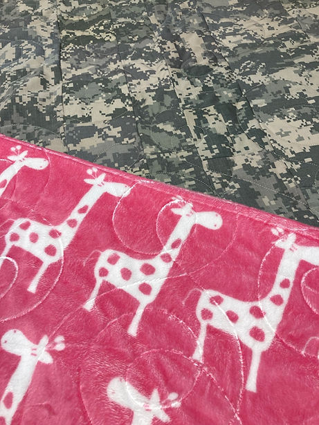 camo and pink giraffes quilt