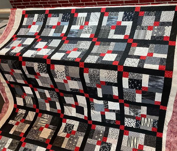 black white red quilt