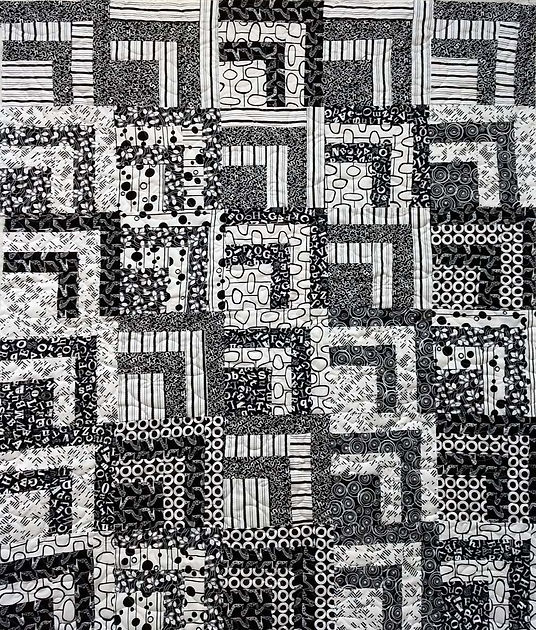 Black and white quilt with longarm quilt