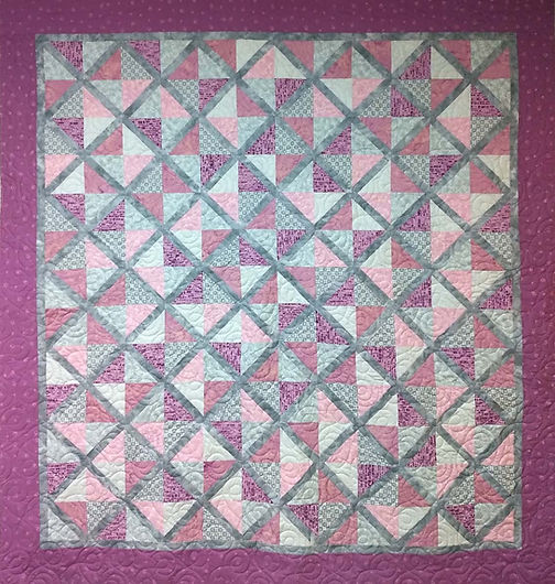 Simple loop longarm quilting on lattice