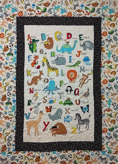 Baby quilt longarm quilt with alphabet.j