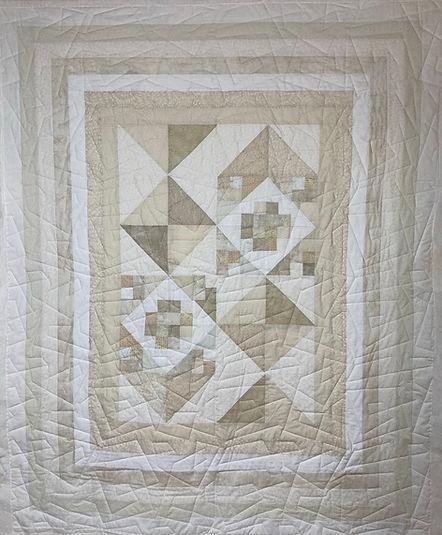Elegant quilt with skewed squares longarm design