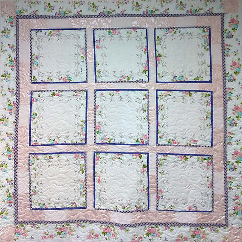 Longarm quilting on Handkerchief quilt.j