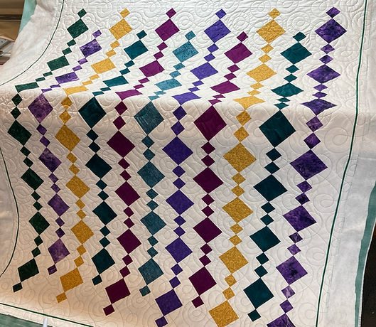 chains of diamonds on white quilt