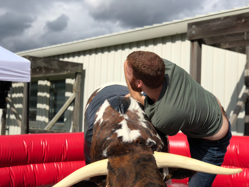 Riding a PBR Mechanical Bull from By the Horns Mechanical Bull Rental Delaware Pennsylvania Maryland
