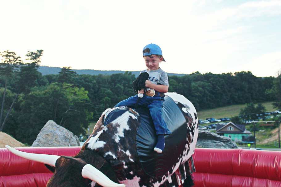 Riding the Mechanical Bull at the Rocky Ridge Ranch Rodeo