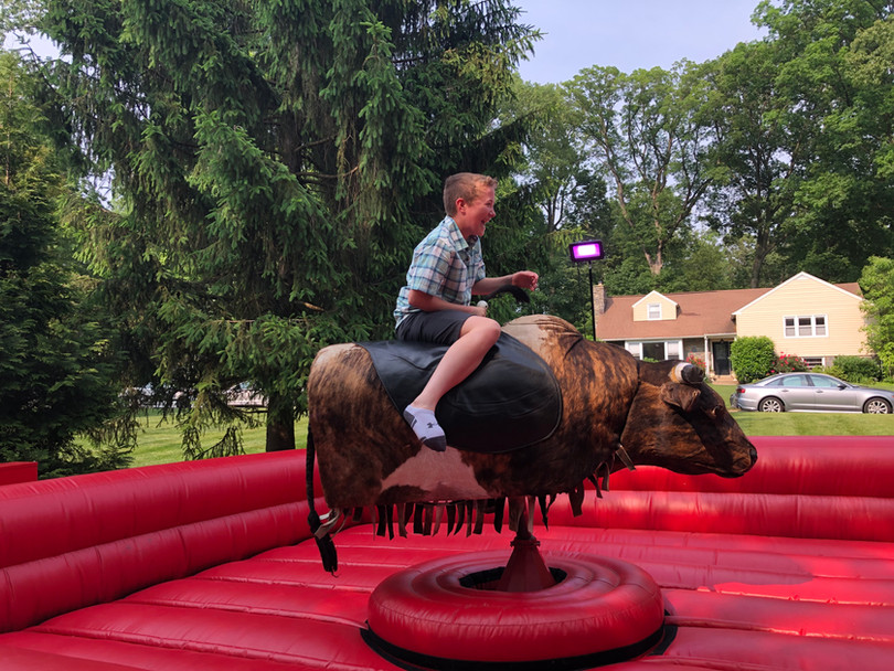 Kid riding PBR Mechanical Bull from By the Horns Mechanical Bull Rental Delaware Pennsylvania Maryland