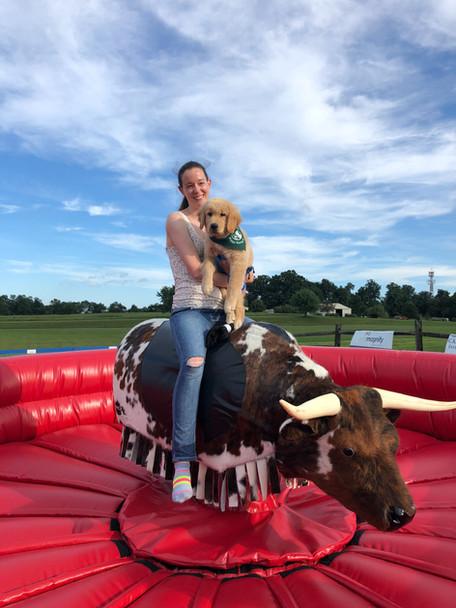 Girl riding PBR Mechanical Bull from By the Horns Mechanical Bull Rental Delaware Pennsylvania Maryland