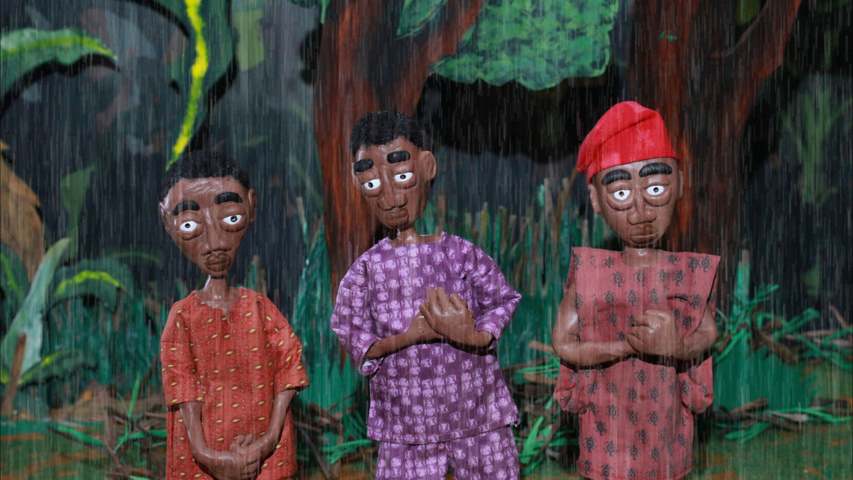 three brothers standing in the rain