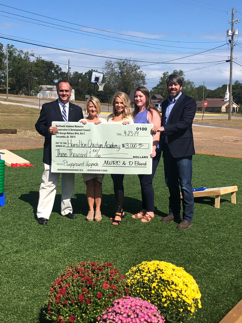 Hamilton Christian School receives a NWRC & D check