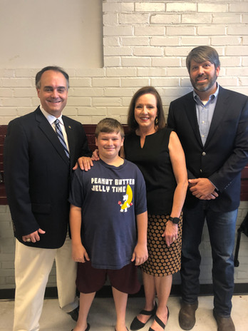 Rep Estes and Senator Gudger pose with the Hamilton Schools Supinertendent and her son