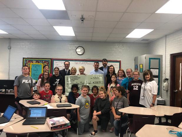 Hamilton Middle School recieves an NWRC & D check