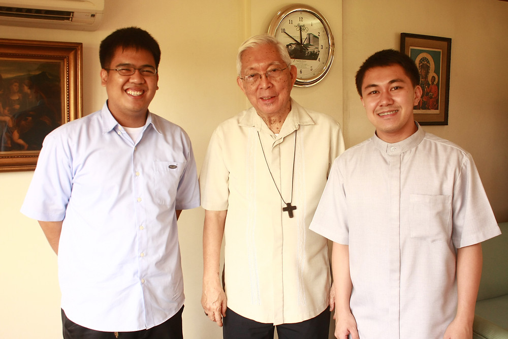 The authors: then-seminarians Fr Bong Bayaras (left) and Fr Kali Llamado (right) with Cardinal Rosales