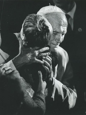 25. His photo embracing an AIDS patient struck the world.