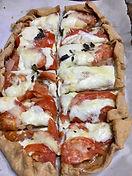 Fresh pizza sliced.jpg